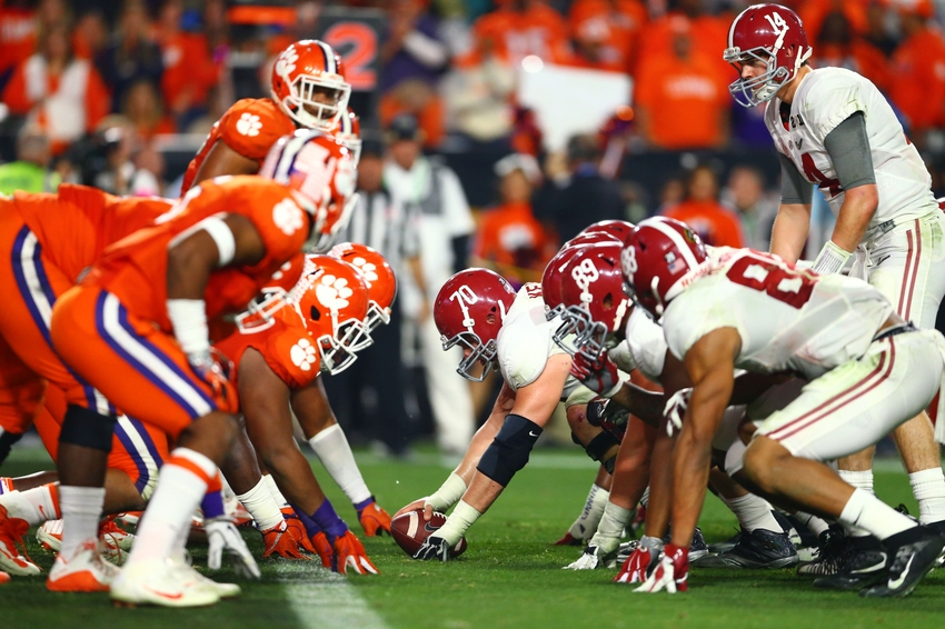 Jan 11, 2016; Glendale, AZ, USA; Alabama Crimson Tide center Ryan Kelly (70) prepares to snap the ball to quarterback Jake Coker (14) against the Clemson Tigers in the 2016 CFP National Championship at University of Phoenix Stadium. Mandatory Credit: Mark J. Rebilas-USA TODAY Sports