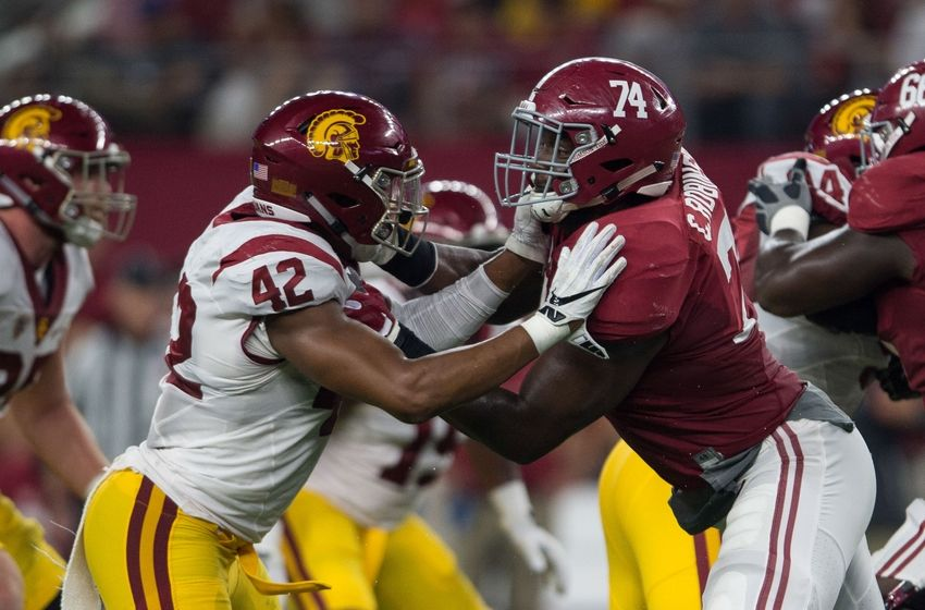 Sep 3, 2016; Arlington, TX, USA; Alabama Crimson Tide offensive lineman Cam Robinson (74) blocks USC Trojans linebacker Uchenna Nwosu (42) during the game at AT&T Stadium. Alabama defeats USC 52-6. Mandatory Credit: Jerome Miron-USA TODAY Sports