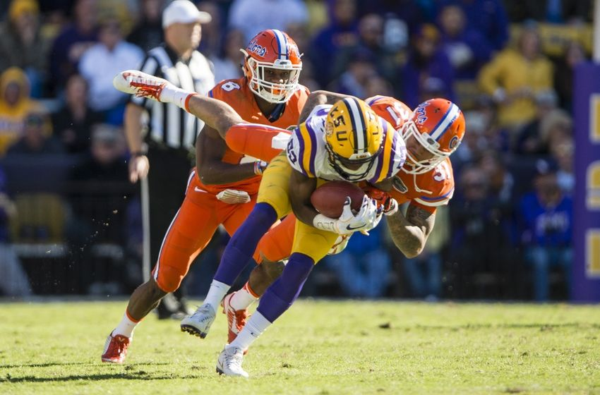 Nov 19, 2016; Baton Rouge, LA, USA; LSU Tigers wide receiver D.J. Chark (82) is tackled by Florida Gators defensive back Teez Tabor (31) during the second half at Tiger Stadium. The Gators defeat the Tigers 16-10. Mandatory Credit: Jerome Miron-USA TODAY Sports