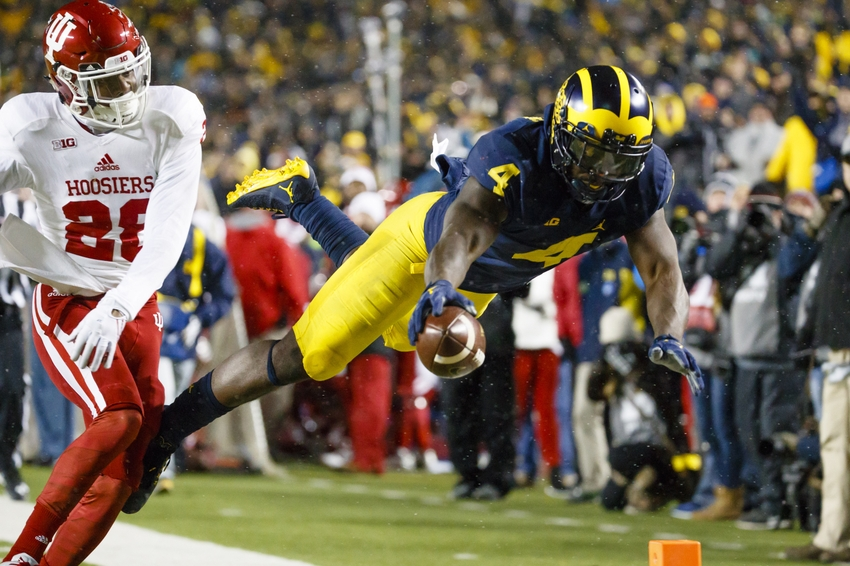Nov 19, 2016; Ann Arbor, MI, USA; Michigan Wolverines running back De'Veon Smith (4) dives into the end zone for a touchdown in the second half defended by Indiana Hoosiers defensive back A'Shon Riggins (28) at Michigan Stadium. Michigan won 20-10. Mandatory Credit: Rick Osentoski-USA TODAY Sports