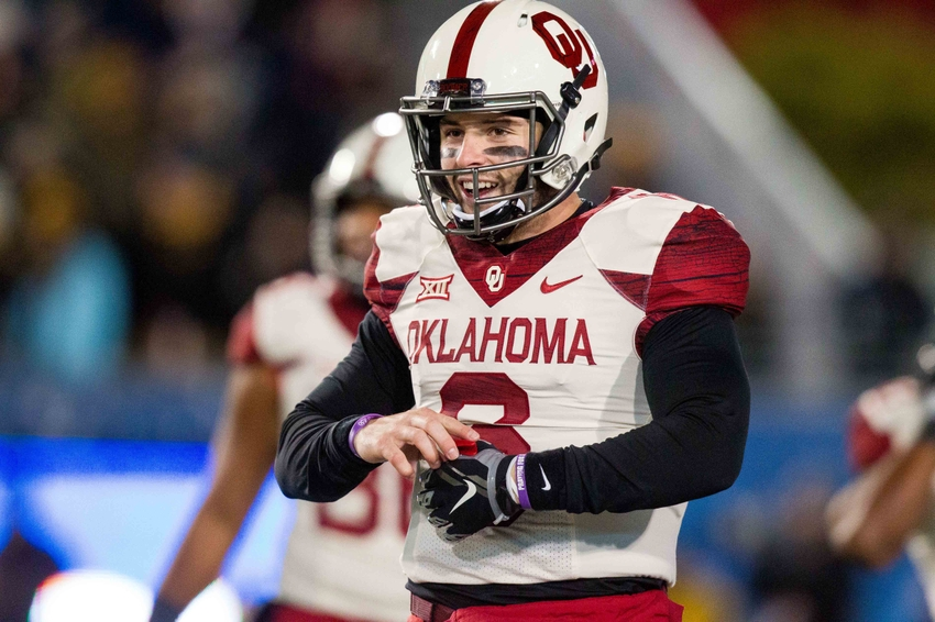 Nov 19, 2016; Morgantown, WV, USA; Oklahoma Sooners quarterback Baker Mayfield (6) smiles after a penalty during the second quarter against the West Virginia Mountaineers at Milan Puskar Stadium. Mandatory Credit: Ben Queen-USA TODAY Sports