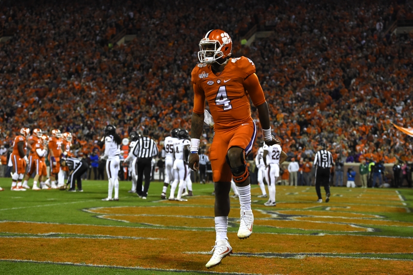 Nov 26, 2016; Clemson, SC, USA; Clemson Tigers quarterback Deshaun Watson (4) celebrates in the end zone after throwing his second touchdown of the first quarter against the South Carolina Gamecocks at Clemson Memorial Stadium. Mandatory Credit: Tommy Gilligan-USA TODAY Sports