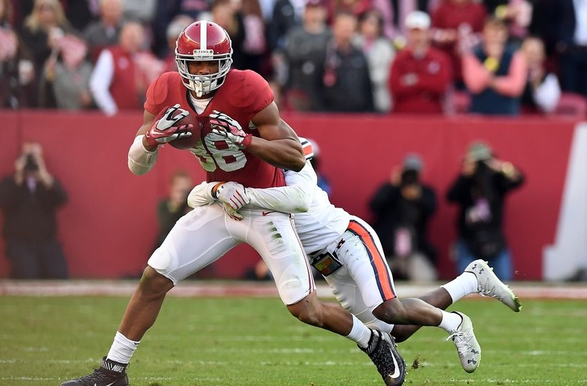 Nov 26, 2016; Tuscaloosa, AL, USA; Alabama Crimson Tide tight end O.J. Howard (88) pulls in a pass against the Auburn Tigers during the second quarter at Bryant-Denny Stadium. Mandatory Credit: John David Mercer-USA TODAY Sports