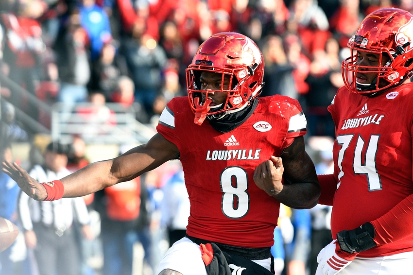 Nov 26, 2016; Louisville, KY, USA; Louisville Cardinals quarterback Lamar Jackson (8) strikes a pose after scoring a touchdown against the Kentucky Wildcats during the second half at Papa John