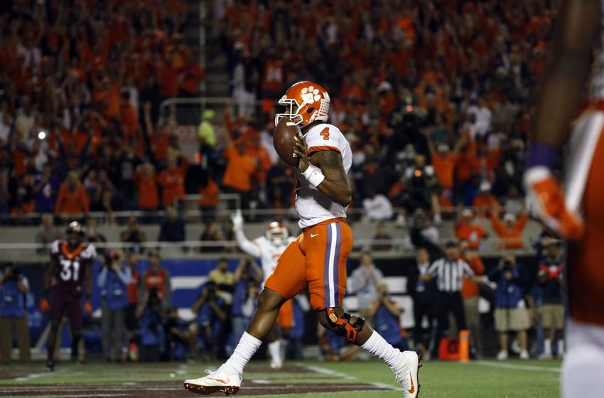 Dec 3, 2016; Orlando, FL, USA; Clemson Tigers quarterback Deshaun Watson (4) runs the ball in for a touchdown during the first quarter of the ACC Championship college football game against the Virginia Tech Hokies at Camping World Stadium. Mandatory Credit: Kim Klement-USA TODAY Sports
