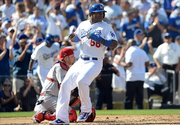 October 16, 2013; Los Angeles, CA, USA; Los Angeles Dodgers right fielder Yasiel Puig (66) scores a run in the second inning against the St. Louis Cardinals in game five of the National League Championship Series baseball game at Dodger Stadium. Mandatory Credit: Jayne Kamin-Oncea-USA TODAY Sports
