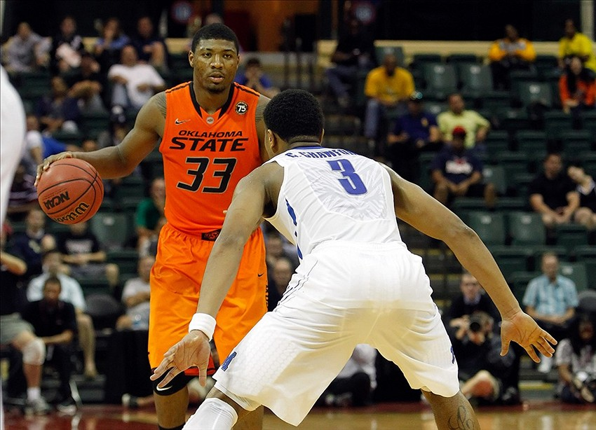 Dec 1, 2013; Lake Buena Vista, FL, USA; Oklahoma State Cowboys guard Marcus Smart (33) drives to the basket Memphis Tigers guard Chris Crawford (3) during the second half at ESPN Wide World of Sports. Memphis Tigers defeated the Oklahoma State Cowboys 73-68. Mandatory Credit: Kim Klement-USA TODAY Sports