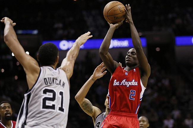 Jan 4, 2014; San Antonio, TX, USA; SLos Angeles Clippers guard Darren Collison (2) takes a shot over San Antonio Spurs forward Tim Duncan (21) during the second half at AT