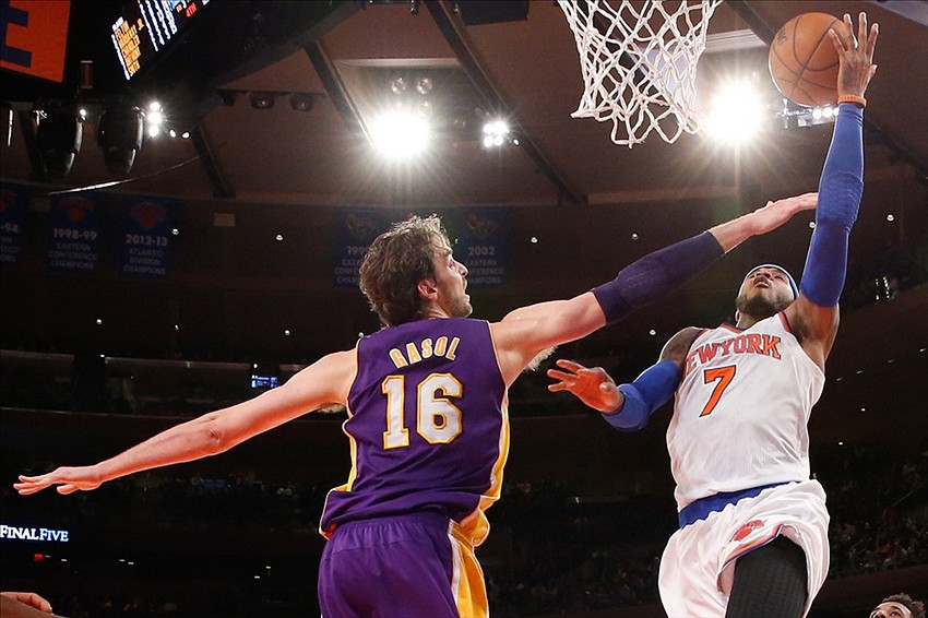 Jan 26, 2014; New York, NY, USA; New York Knicks small forward Carmelo Anthony (7) shoots the ball as Los Angeles Lakers center Pau Gasol (16) defends during the fourth quarter at Madison Square Garden. The Knicks won 110-103. Mandatory Credit: Anthony Gruppuso-USA TODAY Sports