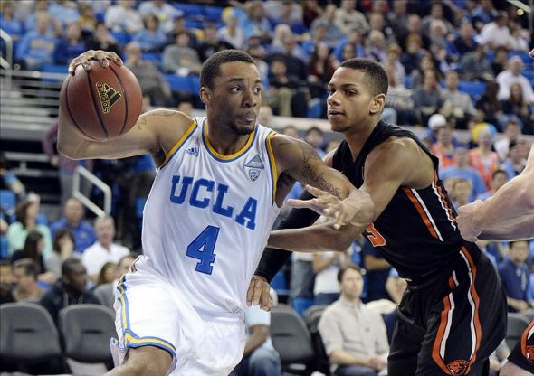 Mar 2, 2014; Los Angeles, CA, USA; UCLA Bruins guard Norman Powell (4) drives past Oregon State Beavers guard Hallice Cooke (3) during the game at Pauley Pavilion. Mandatory Credit: Richard Mackson-USA TODAY Sports