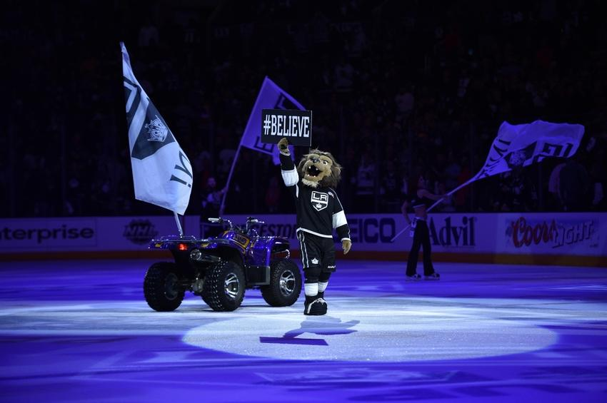 Apr 28, 2014; Los Angeles, CA, USA; Los Angeles Kings mascot Bailey holds up a sign after the game between the San Jose Sharks and Los Angeles Kings in game six of the first round of the 2014 Stanley Cup Playoffs at Staples Center. The Los Angeles Kings won 4-1. Mandatory Credit: Kelvin Kuo-USA TODAY Sports
