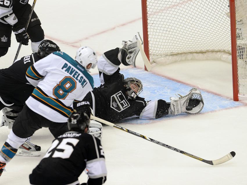 May 28, 2013; Los Angeles, CA, USA; Los Angeles Kings goalie Jonathan Quick (32) makes a save off San Jose Sharks center Joe Pavelski (8) in the third period of game seven of the second round of the 2013 Stanley Cup Playoffs at the Staples Center. Kings won 2-1. Mandatory Credit: Jayne Kamin-Oncea-USA TODAY Sports