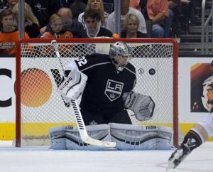 May 14, 2014; Los Angeles, CA, USA; Los Angeles Kings goalie Jonathan Quick (32) makes a save against the Anaheim Ducks in game six of the second round of the 2014 Stanley Cup Playoffs at Staples Center. The Kings defeated the Ducks 2-1 to tie the series 3-3. Mandatory Credit: Kirby Lee-USA TODAY Sports