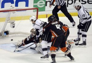 May 16, 2014; Anaheim, CA, USA; Los Angeles Kings right wing Justin Williams (14) scores a goal past Anaheim Ducks goalie John Gibson (36) during the first period in game seven of the second round of the 2014 Stanley Cup Playoffs at Honda Center. Mandatory Credit: Robert Hanashiro-USA TODAY Sports