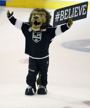 Jun 7, 2014; Los Angeles, CA, USA; The Los Angeles Kings mascot Bailey cheers after the second overtime period during game two of the 2014 Stanley Cup Final at Staples Center. The Kings beat the Rangers 5-4 in overtime. Mandatory Credit: Richard Mackson-USA TODAY Sports