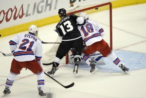 Jun 4, 2014; Los Angeles, CA, USA; Los Angeles Kings left wing Kyle Clifford (13) scores a goal past New York Rangers defenseman Marc Staal (18) in the first period during game one of the 2014 Stanley Cup Final at Staples Center. Mandatory Credit: Richard Mackson-USA TODAY Sports