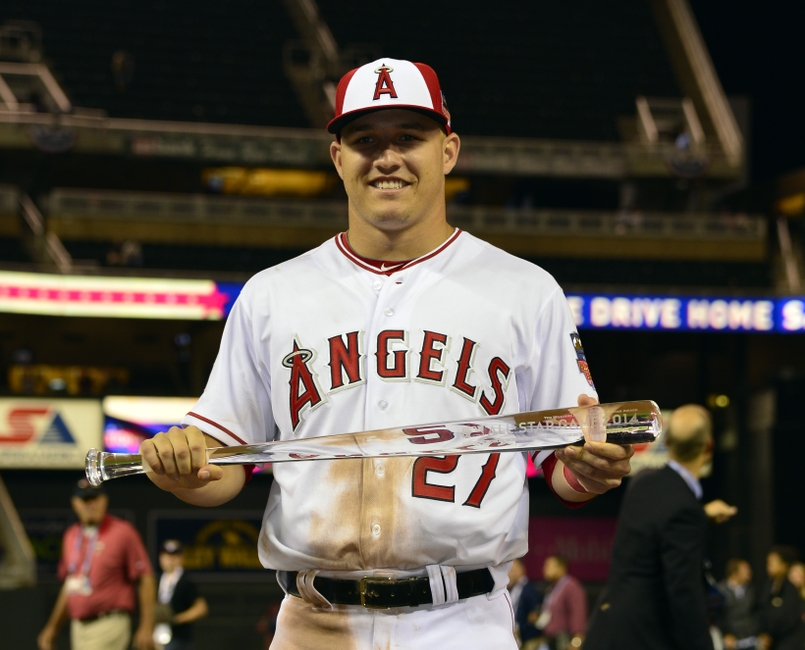 Jul 15, 2014; Minneapolis, MN, USA; American League outfielder Mike Trout (27) of the Los Angeles Angels poses with the MVP trophy after the 2014 MLB All Star Game at Target Field. Mandatory Credit: Scott Rovak-USA TODAY Sports