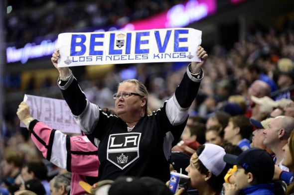 Mar 10, 2015; Denver, CO, USA; A Los Angeles Kings fan reacts to a score in the first period against the Colorado Avalanche at the Pepsi Center. Mandatory Credit: Ron Chenoy-USA TODAY Sports