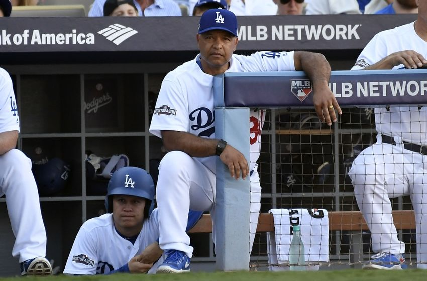 Oct 10, 2016; Los Angeles, CA, USA; Los Angeles Dodgers manager Dave Roberts (30) in the dugout during the sixth inning against the Washington Nationals in game three of the 2016 NLDS playoff baseball series at Dodger Stadium. Mandatory Credit: Richard Mackson-USA TODAY Sports
