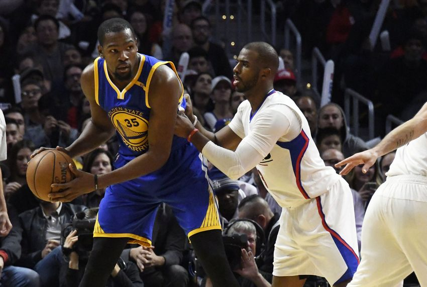 9731227-kevin-durant-chris-paul-nba-golden-state-warriors-los-angeles-clippers