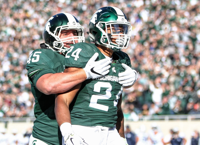 9595552-ncaa-football-brigham-young-michigan-state