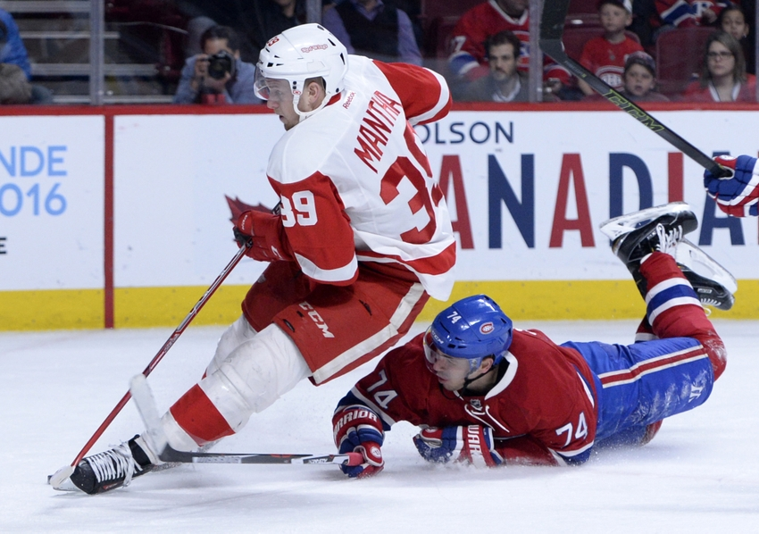 9218412-alexei-emelin-anthony-mantha-nhl-detroit-red-wings-montreal-canadiens