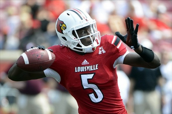 Sep 7, 2013; Louisville, KY, USA; Louisville Cardinals quarterback Teddy Bridgewater (5) looks to pass against the Eastern Kentucky Colonels during the second half of play at Papa John