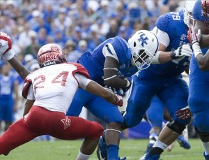 Sep 7, 2013; Lexington, KY, USA; Kentucky Wildcats running back Raymond Sanders (4) runs for a touchdown against Miami (Oh) Redhawks Heath Harding (24) at Commonwealth Stadium. Mandatory Credit: Mark Zerof-USA TODAY Sports