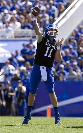 Sep 14, 2013; Lexington, KY, USA; Kentucky Wildcats quarterback Maxwell Smith (11) throws a pass against the Louisville Cardinals at Commonwealth Stadium. Louisville defeated Kentucky 27-13. Mandatory Credit: Mark Zerof-USA TODAY Sports