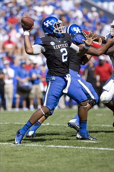 Sep 14, 2013; Lexington, KY, USA; Kentucky Wildcats quarterback Jalen Whitlow (2) throws a pass against the Louisville Cardinals at Commonwealth Stadium. Louisville defeated Kentucky 27-13. Mandatory Credit: Mark Zerof-USA TODAY Sports