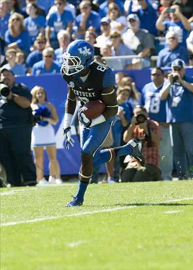 Sep 14, 2013; Lexington, KY, USA; Kentucky Wildcats wide receiver Javess Blue (8) runs a kick off return against the Louisville Cardinals at Commonwealth Stadium. Louisville defeated Kentucky 27-13. Mandatory Credit: Mark Zerof-USA TODAY Sports