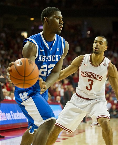 March 2, 2013; Fayetteville, AR, USA; Kentucky Wildcats forward Alex Poythress (22) looks to pass under pressure from Arkansas Razorbacks guard Rickey Scott (3) during a game at Bud Walton Arena. Arkansas defeated Kentucky 73-60. Mandatory Credit: Beth Hall-USA TODAY Sports