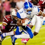 Oct 5, 2013; Columbia, SC, USA; Kentucky Wildcats running back Jojo Kemp (3) rushes past South Carolina Gamecocks linebacker Skai Moore (10) in the second quarter at Williams-Brice Stadium. Mandatory Credit: Jeff Blake-USA TODAY Sports