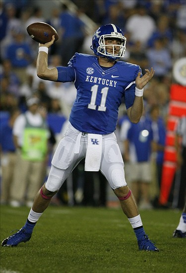 Oct 12, 2013; Lexington, KY, USA; Kentucky Wildcats quarterback Maxwell Smith(11) passes the ball against the Alabama Crimson Tide at Commonwealth Stadium. Mandatory Credit: Mark Zerof-USA TODAY Sports