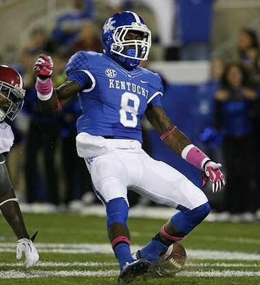 Oct 12, 2013; Lexington, KY, USA; Kentucky Wildcats wide receiver Javess Blue (8) scores a touchdown against the Alabama Crimson Tide at Commonwealth Stadium.Alabama defeated Kentucky 48-7. Mandatory Credit: Mark Zerof-USA TODAY Sports
