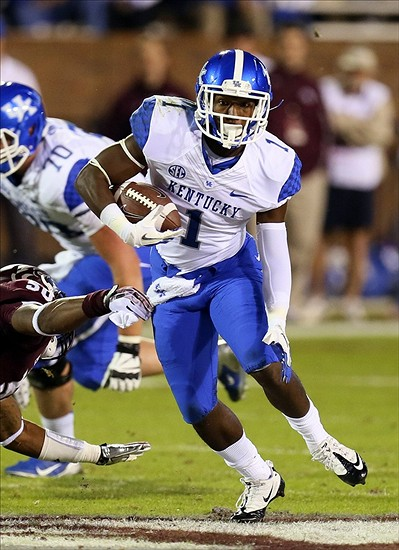 Oct 24, 2013; Starkville, MS, USA; Kentucky Wildcats running back Ryan Timmons (1) advances the ball during the game against the Mississippi State Bulldogs at Davis Wade Stadium. Mandatory Credit: Spruce Derden-USA TODAY Sports