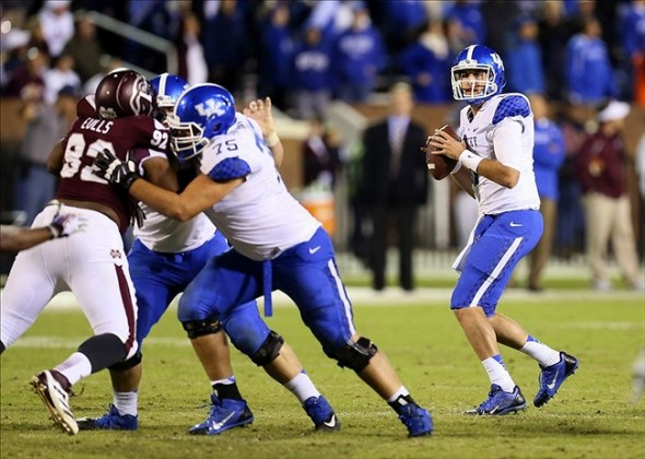 Oct 24, 2013; Starkville, MS, USA; Kentucky Wildcats quarterback Maxwell Smith (11) drops back for a pass during the game against the Mississippi State Bulldogs at Davis Wade Stadium. Mississippi State Bulldogs win the game against Kentucky Wildcats 28-22. Mandatory Credit: Spruce Derden-USA TODAY Sports