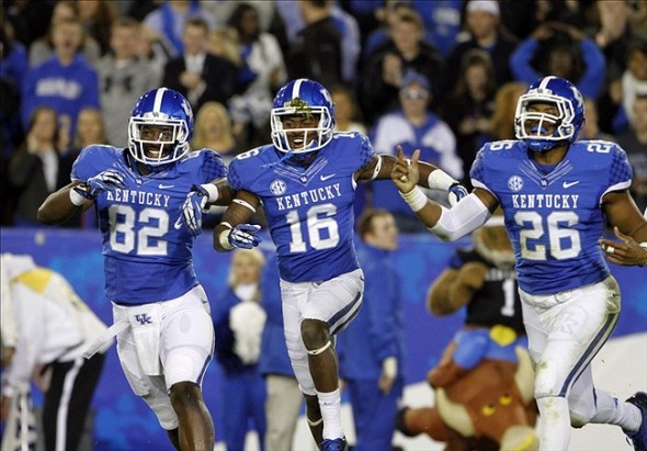 Nov 2, 2013; Lexington, KY, USA; Kentucky Wildcats tight end Anthony Kendrick (82) , cornerback Cody Quinn (16) and linebacker Tre