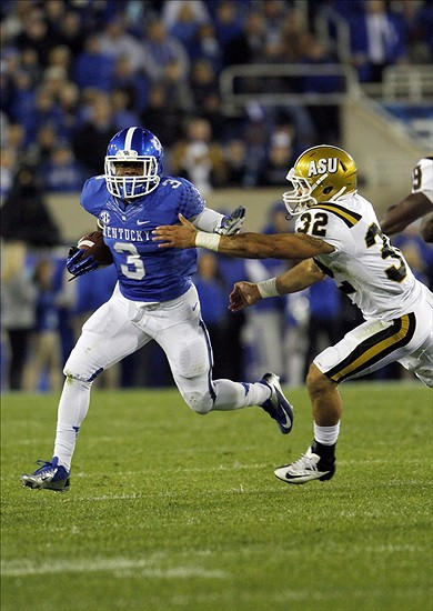 Nov 2, 2013; Lexington, KY, USA; Kentucky Wildcats running back Jojo Kemp (3) runs the ball against Alabama State Hornets linebacker Rodney Cross (32) at Commonwealth Stadium. Mandatory Credit: Mark Zerof-USA TODAY Sports