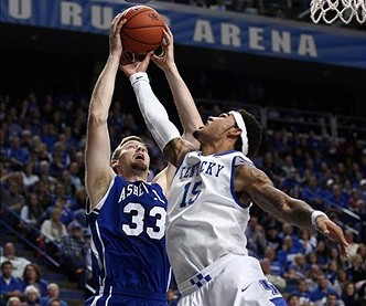Nov 8, 2013; Lexington, KY, USA; Kentucky Wildcats forward Willie Cauley-Stein (15) and NC-Asheville Bulldogs center D.J. Cunningham (33) battle for a rebound in the first half at Rupp Arena. Mandatory Credit: Mark Zerof-USA TODAY Sports