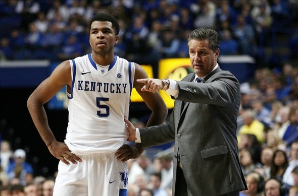 Nov 10, 2013; Lexington, KY, USA; Kentucky Wildcats head coach John Calipari gives instructions to guard Andrew Harrison (5) during the game against the Northern Kentucky Norse at Rupp Arena.Kentucky defeated Northern Kentucky 93-63. Mandatory Credit: Mark Zerof-USA TODAY Sports