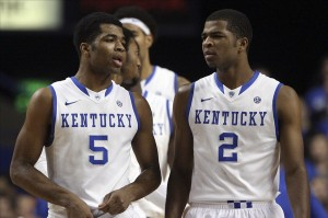 Nov 25, 2013; Lexington, KY, USA; Kentucky Wildcats guard Andrew Harrison (5) and guard Aaron Harrison (2) talk during a time out in the game against the Cleveland State Vikings at Rupp Arena. Kentucky defeated Cleveland State 68-61. Mandatory Credit: Mark Zerof-USA TODAY Sports