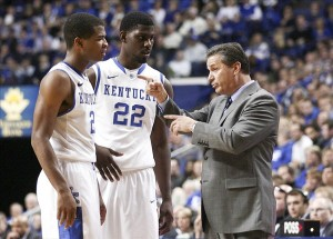 Nov 27, 2013; Lexington, KY, USA; Kentucky Wildcats head coach John Calipari gives instructions to forward Alex Poythress (22) and guard Aaron Harrison (2) during the game against the East Michigan Eagles in the second half at Rupp Arena. Kentucky defeated East Michigan 81-63. Mandatory Credit: Mark Zerof-USA TODAY Sports