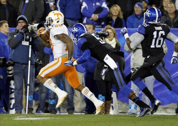 Nov 30, 2013; Lexington, KY, USA;Tennessee Volunteers running back Rajion Neal (20) runs for a touchdown against Kentucky Wildcats safety Ashely Lowery (5) and cornerback Cody Quinn (16) in the first half at Commonwealth Stadium. Mandatory Credit: Mark Zerof-USA TODAY Sports