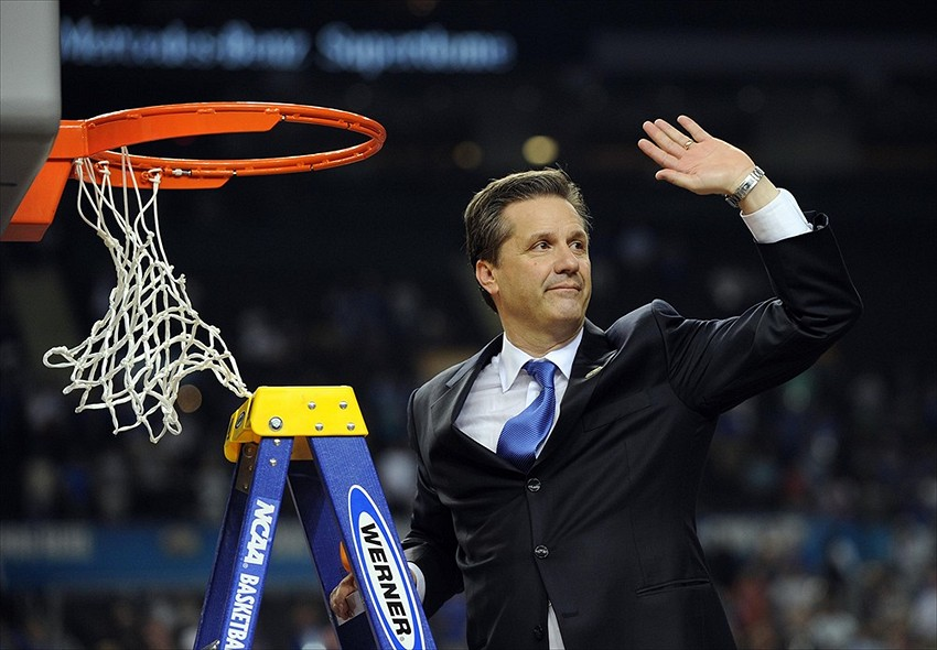 Apr 2, 2012; New Orleans, LA, USA; Kentucky Wildcats head coach John Calipari waves to the crowd as he cuts down a piece of the net after the finals of the 2012 NCAA men