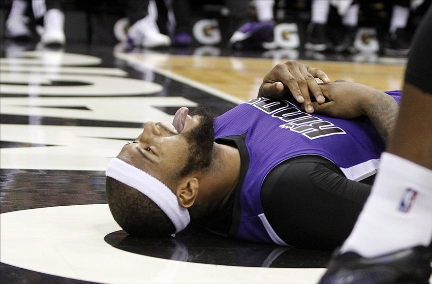 Dec 21, 2013; Orlando, FL, USA; Sacramento Kings center DeMarcus Cousins (15) reacts on the ground after a foul was called on him against the Orlando Magic during the second half at Amway Center. Sacramento Kings defeated the Orlando Magic 105-100. Mandatory Credit: Kim Klement-USA TODAY Sports