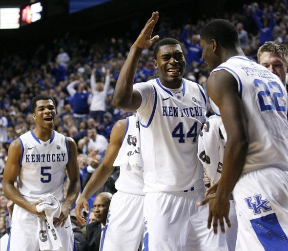 Jan 21, 2014; Lexington, KY, USA; Kentucky Wildcats center Dakari Johnson (44) and guard Andrew Harrison (5) celebrate with forward Alex Poythress (22) during the game against the Texas A