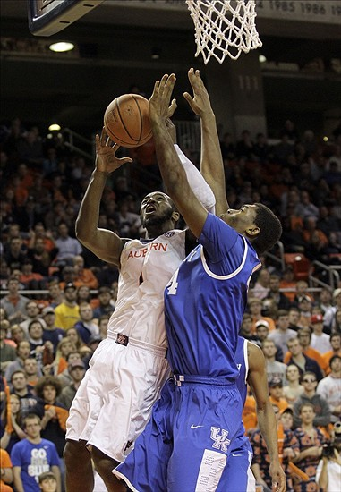 Feb 12, 2014; Auburn, AL, USA; Auburn Tigers guard K.T. Harrell (1) takes a shot against Kentucky Wildcats center Dakari Johnson (44) during the second half at Auburn Arena. The Wildcats beat the Tigers 64-56. Mandatory Credit: John Reed-USA TODAY Sports