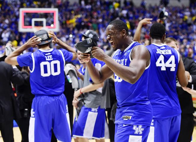 Mar 30, 2014; Indianapolis, IN, USA; Kentucky Wildcats forward Julius Randle (30) celebrates with teammates after defeating the Michigan Wolverines in the finals of the midwest regional of the 2014 NCAA Mens Basketball Championship tournament at Lucas Oil Stadium. Mandatory Credit: Bob Donnan-USA TODAY Sports