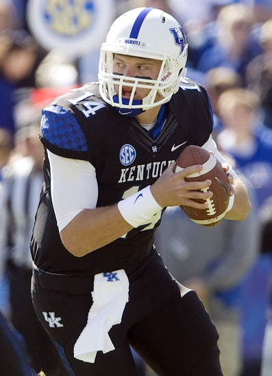 Oct 6, 2012; Lexington, KY, USA; Kentucky Wildcats quarterback Patrick Towles (14) passes the ball against the Mississippi State Bulldogs at Commonwealth Stadium. Credit: Mark Zerof-USA TODAY Sports